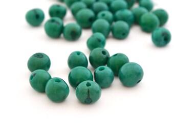 10 green round 6-10mm Acai seed beads