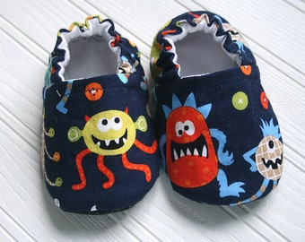 Monster Mash cotton slippers.  Crazy monsters on navy background. Grip tight soles for 9 months up.  Cotton, flannel. Made to order.