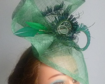 Green fascinator with sword feathers
