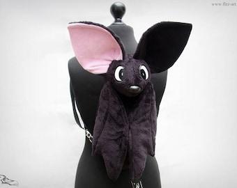 Bat backpack (black right inner ear pink)
