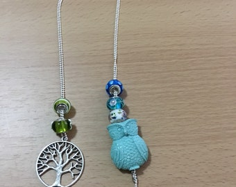 Necklaces with fairy cameos, owls and tree of life.