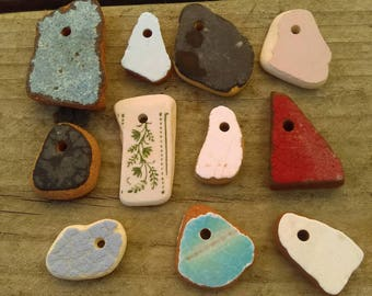 11 drilled pieces of genuine irish sea ceramic, porcelain,pottery. (see picture)