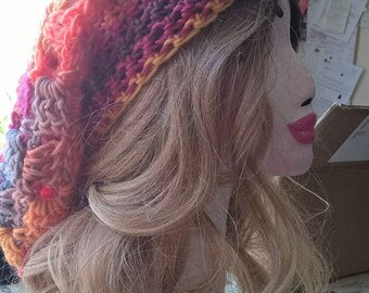 gorgeous hand crocheted slouch hat in oranges, reds and blues