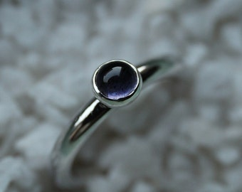 Silver stacking ring with iolite.