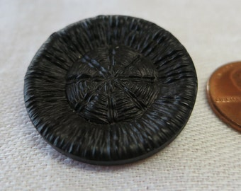 "2 Vintage plastic buttons, black, look like woven raffia, or old Dorset style. approx 1"", 1 slightly smaller, shank back.  HM15.1-25.8."