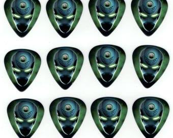 12 Pack Guitar Picks ALIEN ARRIVAL CYBORG Monster Creature Creepy Scary Freaky