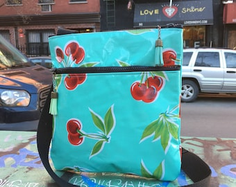 Turquoise Cherry Print Oil Cloth Messenger Saddle Bag, Cross body Vinyl Shoulder Bag