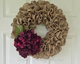 Tan ruffle burlap wreath accented with deep purple hydrangea
