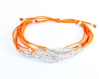 Orange multi strand pearl bracelet