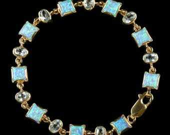 Opal Blue Topaz Gold Bracelet 9ct Gold