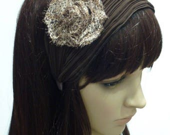Headband wide pleated very thin chiffon with flower on the side.
