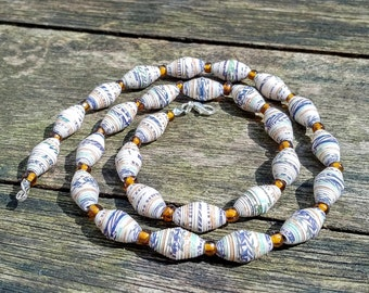 Handmade necklace with multicolor, beige - blue - green - brown recycled paper and dark amber glass beads