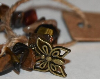 Butterfly bronze effect charm and mixed brown  gemstone bracelet