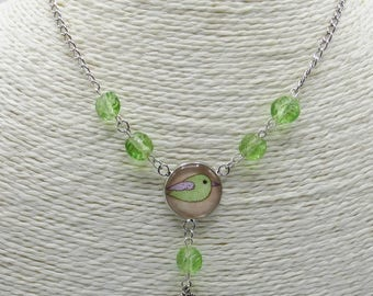 Green bird necklace in glass beads