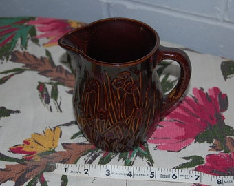 Vintage brown pottery with floral detailing  McCoy?