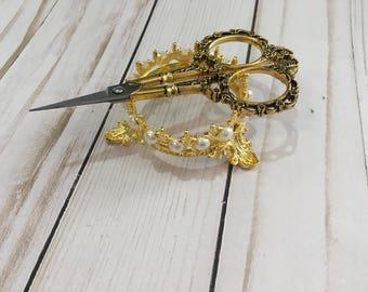 Vintage scissors and crown holder