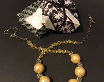 Yellow and gold beaded chain necklace in a gift box