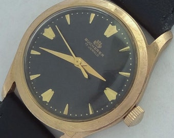 17 Jewels Swiss made Bucherer Men's vintage watch gold filled 20 Microns very rare black dial.