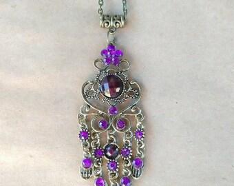 Beautiful purple and bronze pendant on chain