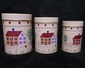 Set Of Three Nesting Canisters Metal Tins Country Theme Sampler Style Beige Vintage Kitchen American Gothic