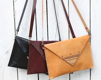 Envelope clutch bag with detachable strap & wood detail