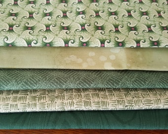 Green fabric Bundle of 5 quilting fabrics including a Fat quarter of a batiks leaf print