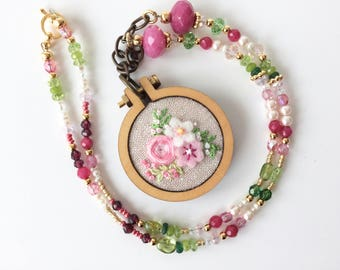 hand embroidered tiny hoop pendant with a pink and green beaded necklace