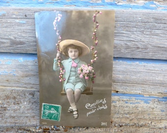 Vintage Antique 1900/1910 French real recolored photography postcard boy on a balançoire