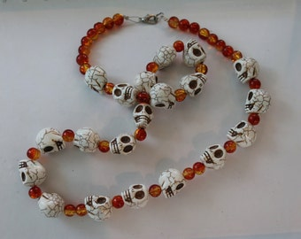 Skeleton necklace with foil orange beads.
