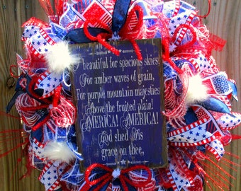 """Patriotic Wreath with """"O Beautiful"""" Lyrics on a distressed wooden sign.  Beautiful Red, white and Blue wreath to display."""