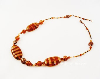 Copper and gold banded bead necklace