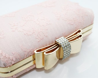 Peach lace with gold bow dressing case