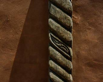 TAOS ARCHITECTURAL DETAIL of New Mexicon Wood Carving and Adobe Texture.