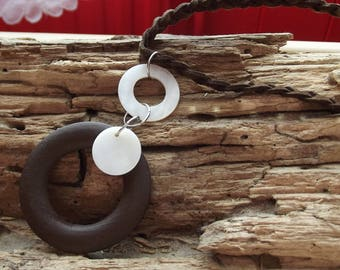 Rings and stressed cord necklace