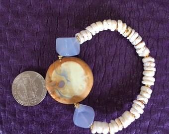 Chalcedony, River polished Agate Puka Shell
