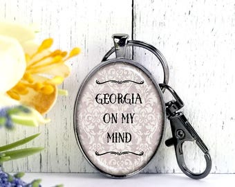 Georgia On My Mind-Cowgirl Themed Collection-Large Oval- Glass Bubble Pendant Key Chain