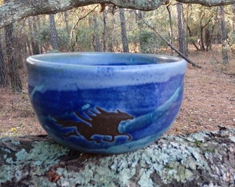 The wild horses of Corolla gallop around the outside of this sweet little cereal bowl