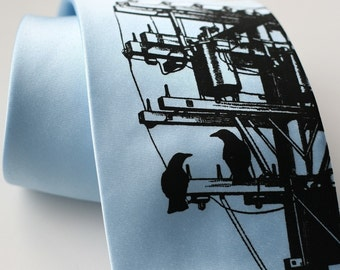 "Transformer ""Power Tie."" Screenprinted sky blue necktie with birds, rabbits, wire, and electric pole. Choose  standard or narrow width."