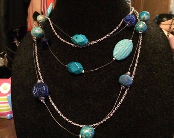 Blue floating beads