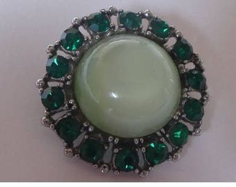 Vintage 1950s brooch. Green stones and opal type centre