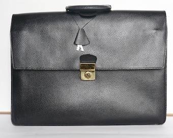 Tanner - door papers - vintage 90s black leather