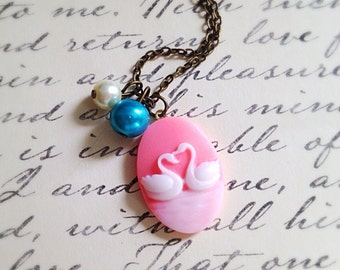Love Swans Oval Necklace. Pink. Romantic. Pastel Pearls. Birds. White. Under 20 Gifts for Her. Exotic Birds. Brass Vintage Style.