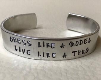 """S'habiller comme un modèle, vivre comme une manchette thug 1/2"""" en aluminium"""