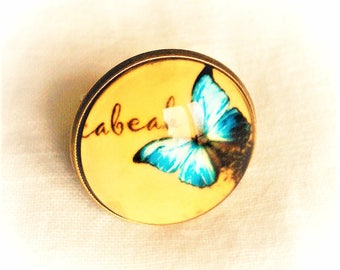 illustrated yellow cabochon blue butterfly Ring