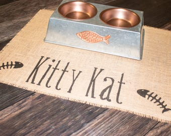 Kitty Pet placemat for cat food bowls - personalized with your pets name between the fish bones!