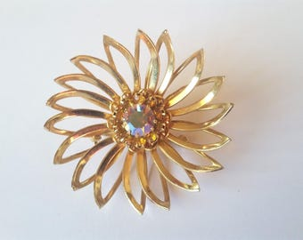 Vintage Sara Coventry gold tone flower brooch with aurora borealis rhinestone. Mid century made in Canada signed