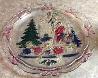 "A Round Glass Serving Platter with a Colorful Christmas Scene, ""Christmas Joy""."
