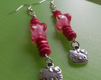 Character dangling earrings inspired by 'Hello Kitty'.