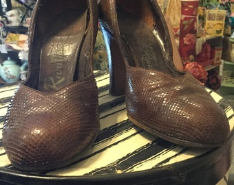 Vintage brown snake skin shoes.
