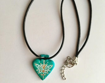 Handmade turquoise blue necklace with pattern detail